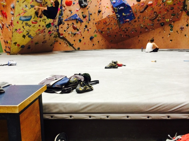 Climbers hang out around the bouldering wall at Earth Treks in Timonium, Md.